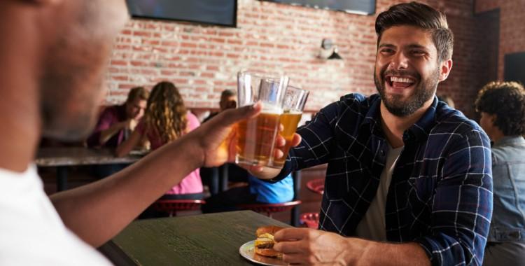 man smiling at a sports bar