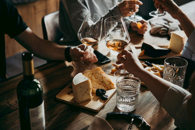 Clinking Glasses at a Wine Pairing