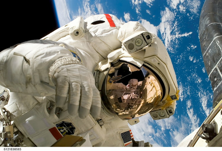 American Astronaut floating in space