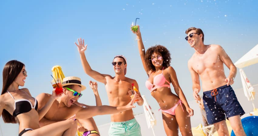 young people partying on a beach