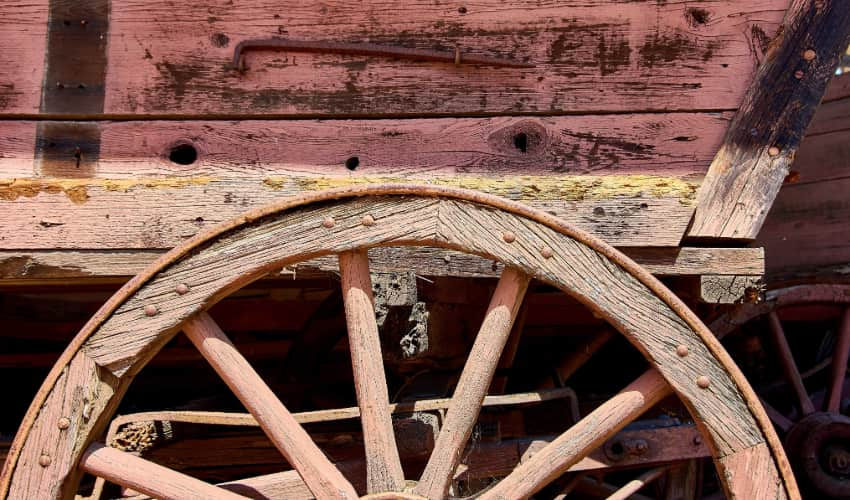 close-up image of a stagecoach's wagon wheel
