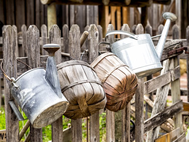 Buckets on fence at Dallas Heritage Village