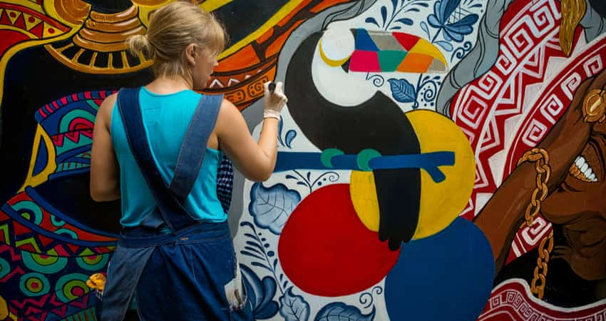 An artist painting a colorful mural