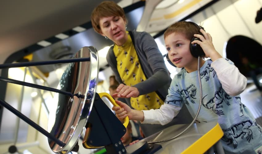 A child plays with a radar replica at a space museum