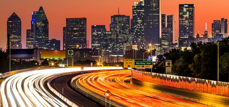 a long exposure of a dallas highway after sunset