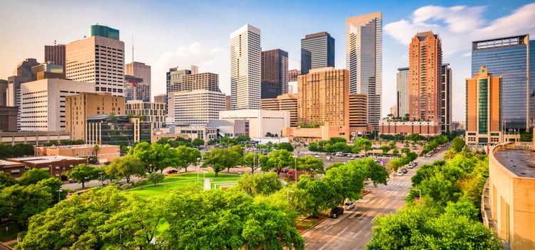 a view of the houston skyline on a sunny day