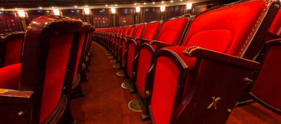 inside of a theater with close up on red seats